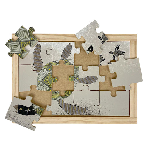 Australian-made wooden puzzle, featuring aboriginal art sea turtles swimming with baby turtles. Designed for childcare.