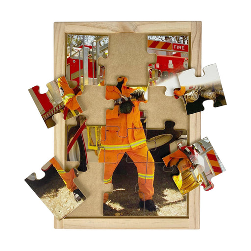 Australian-made wooden puzzle, featuring a male fireman with fire truck and fire hose, designed for childcare.