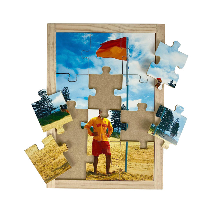 Australian-made wooden puzzle, featuring a male life guard on the beach, staying between the flags, designed for childcare.