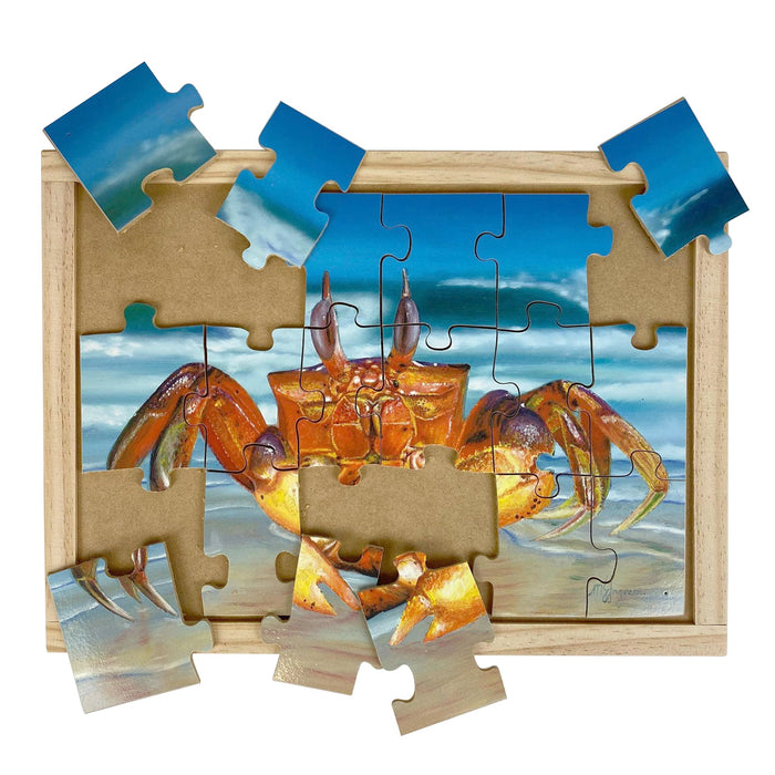 Australian-made wooden puzzle, featuring artwork of a ghost crab on a sandy beach. Designed for childcare.