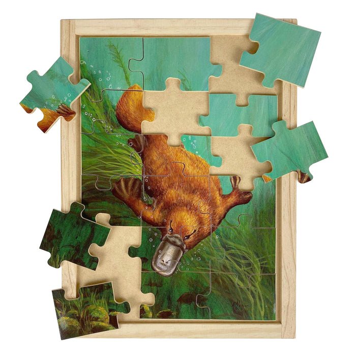Australian-made wooden puzzle, featuring artwork of a platypus swimming in the billabong. Designed for childcare.