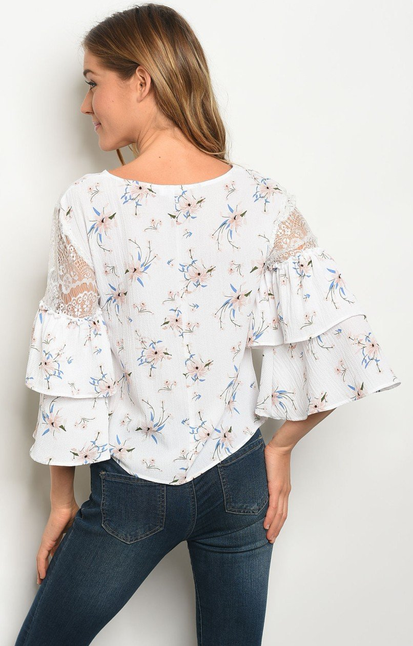 Meika top in white with peach and blue floral