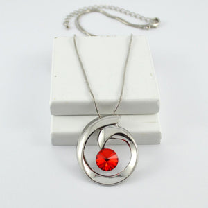 Silver Swirl Pendant with Red Crystal