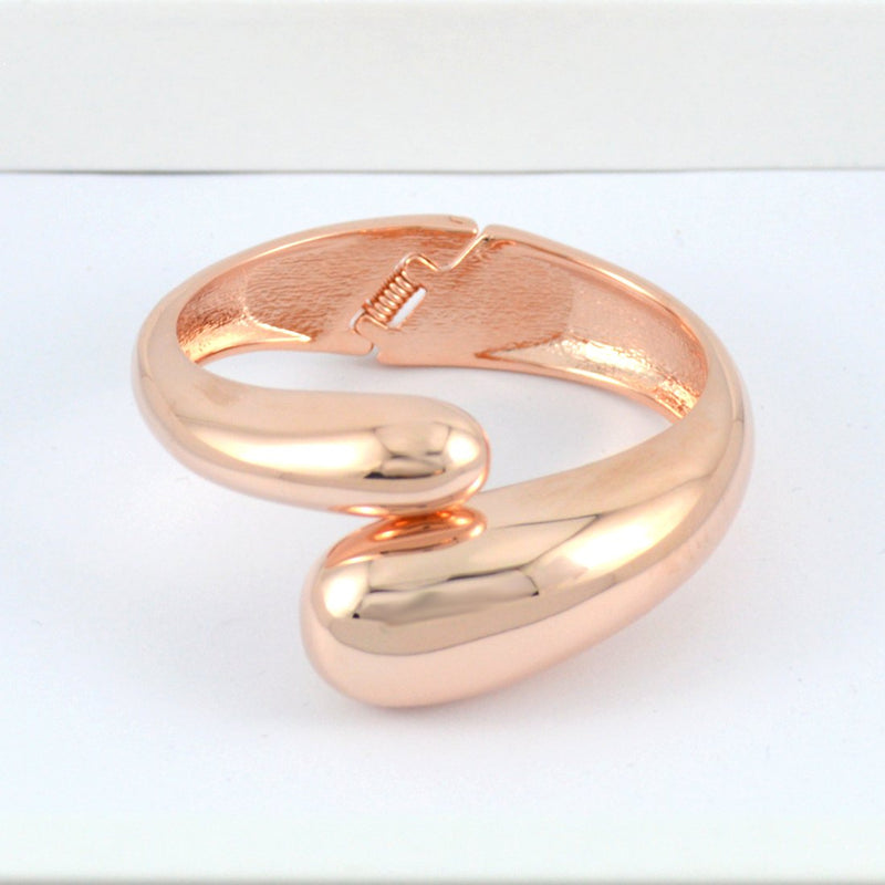 Rose Gold Cross Over Bangle
