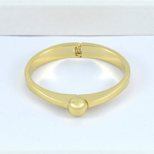 Gold Bracelet with Gold Pearl