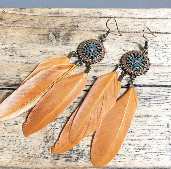 Feather earring in orange