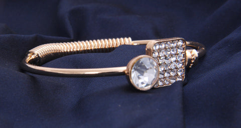 Rose Gold Tone Bracelet With White Stone
