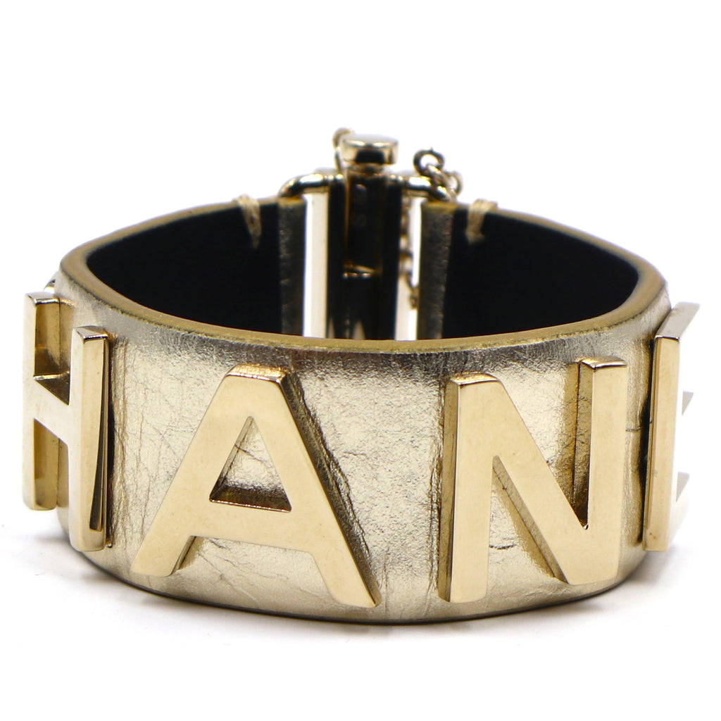 Chanel Gold Spelled Out Glide Lock Cuff Bangle