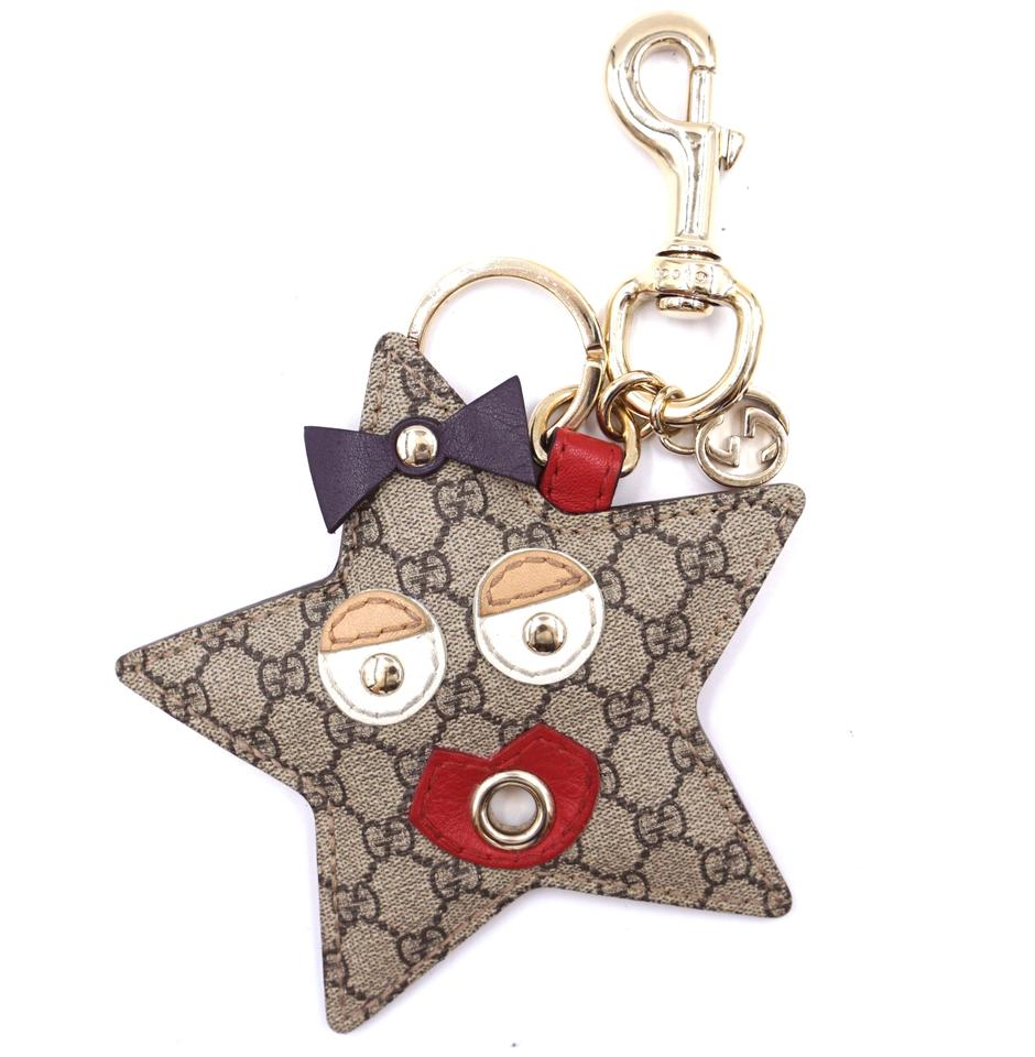 Gucci Brown Supreme Logo Star Fish Key Charm