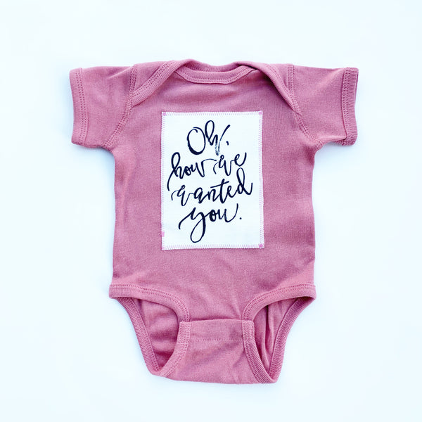 """Oh How We Wanted You"" Onesie - MAUVE"