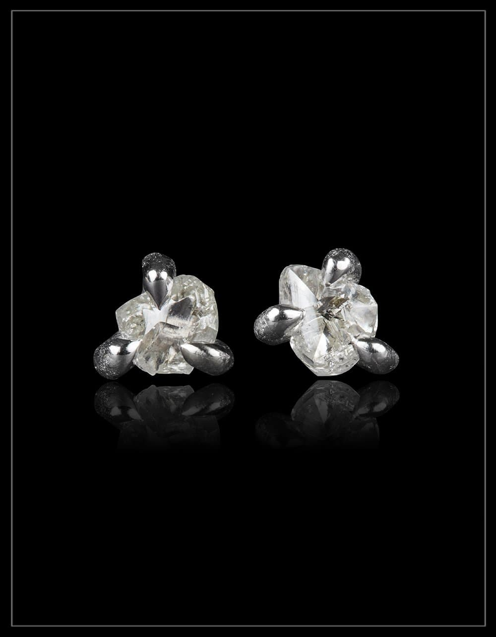 3 prong white gold earrings  - <strong> 0.52 ct. </strong>