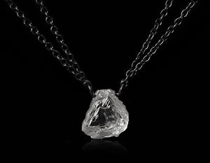 <strong>1.76 ct.</strong> Natural Whitish Rough diamond in double 18K black rhodium white gold necklace