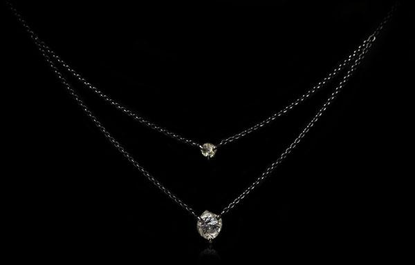 <strong>2.48 ct.</strong> Natural Rough diamonds in 18K double black rhodium white gold necklaces