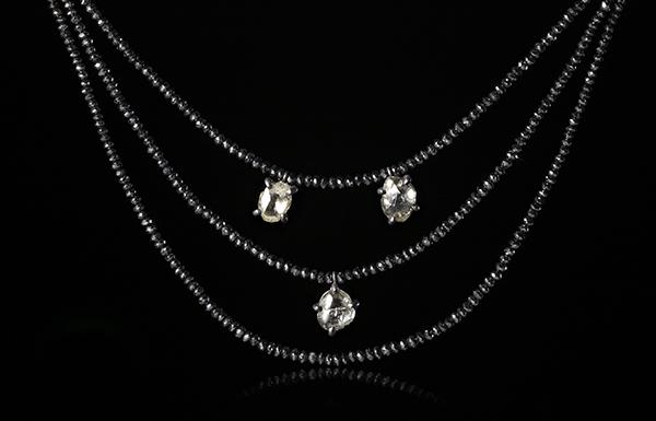 <strong>6.11 ct.</strong> Natural Rough diamonds & <strong>48.28 ct.</strong> Black Facetted diamonds in a collier
