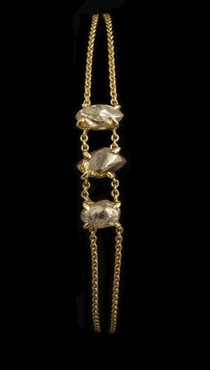 <strong>4.84 ct.</strong> Natural Rough diamonds in 18K gold chain bracelet