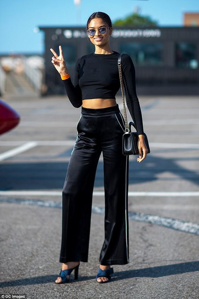 9c52919f1a Shanina looking comfortable in an all-black outfit. She is in a  long-sleeved crop paired with high-waisted silk pants. She has given the  outfit a lift with ...