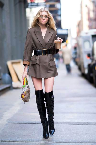f43ba8195e7 The model brings fun to the modern-day work outfit. With over the knee boots