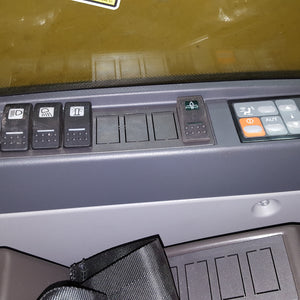 Manually lubrication switch installed inside cab