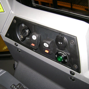 Manual push button located in operator cab
