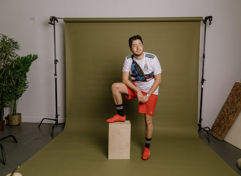 young man dressed as Mexico soccer player for Halloween and pairing it with a fancy pack