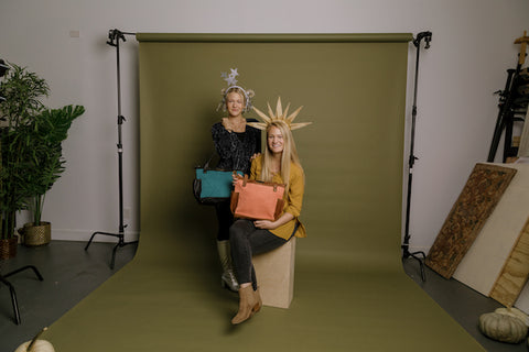 young women dressing up as the sun and stars for Halloween with Nena & Co. handbags matching each outfit