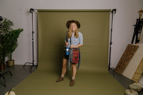 Young woman dressed up as a safari guide for Halloween and pairing it with a Nena & Co. bag