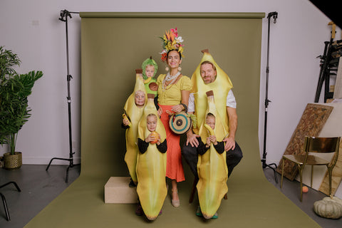 s family costume with mother as miss chiquita, her husband and triplets as bananas and her baby as an avocado.