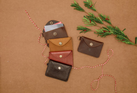 Flat lay of 4 different full leather artisan card holders from Nena & Co.