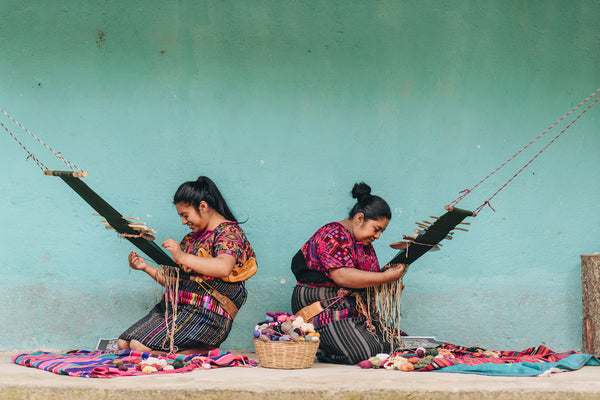 Two female Artisans in Guatemala weaving with a Backstrap Loom