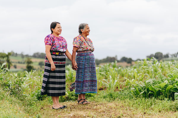 Two indigenous women Artisans in their traditional Guatemalan outfits