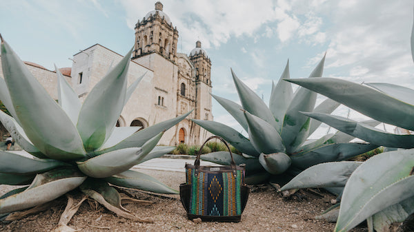 Nena & Co. Mexico Tumbled Leather Bag in front of a church in Oaxaca, Mexico