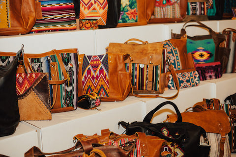 All different kinds of Nena & Co. bags organized on shelves.