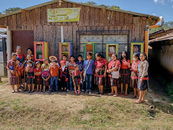 Kids in Guatemala standing in front of a school.