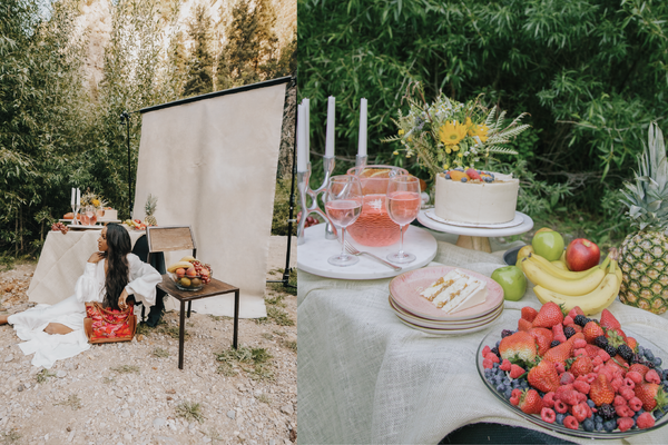 A collage of two images. On the left side is an image of a black female model laying on the ground outdoors in front of a backdrop, table with fruit, chair, and a purse. The other image is an close up of the table with the fruit.