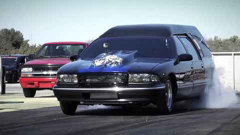 The Iron Maiden Madness Hearse is a fully functional Chevy Caprice outfitted as a hearse, complete with coffin loaded in the back.