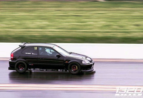 1320video.com shot this image of Manny Iwabuchi making a pass in the PTP official shop car, the Honda Civic Type R.