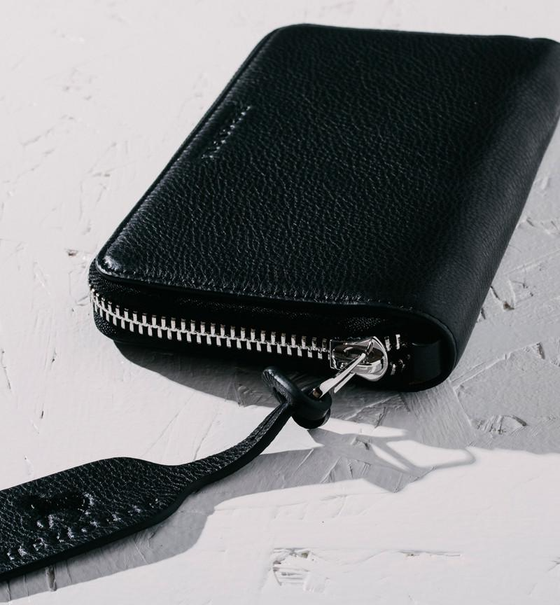black leather wallet pictured flat angle