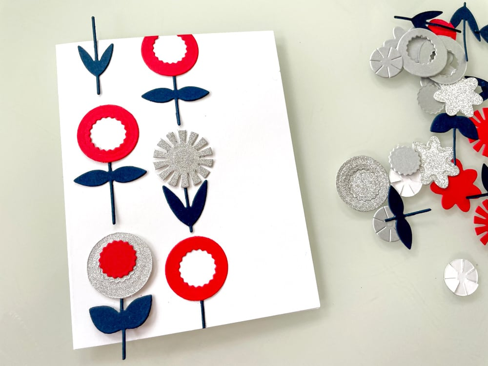 gluing flowers to left side of card