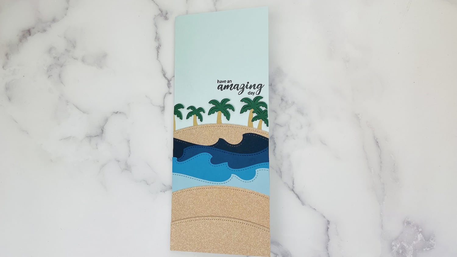 Sand, waves, trees, and stamped sentiment added to card base