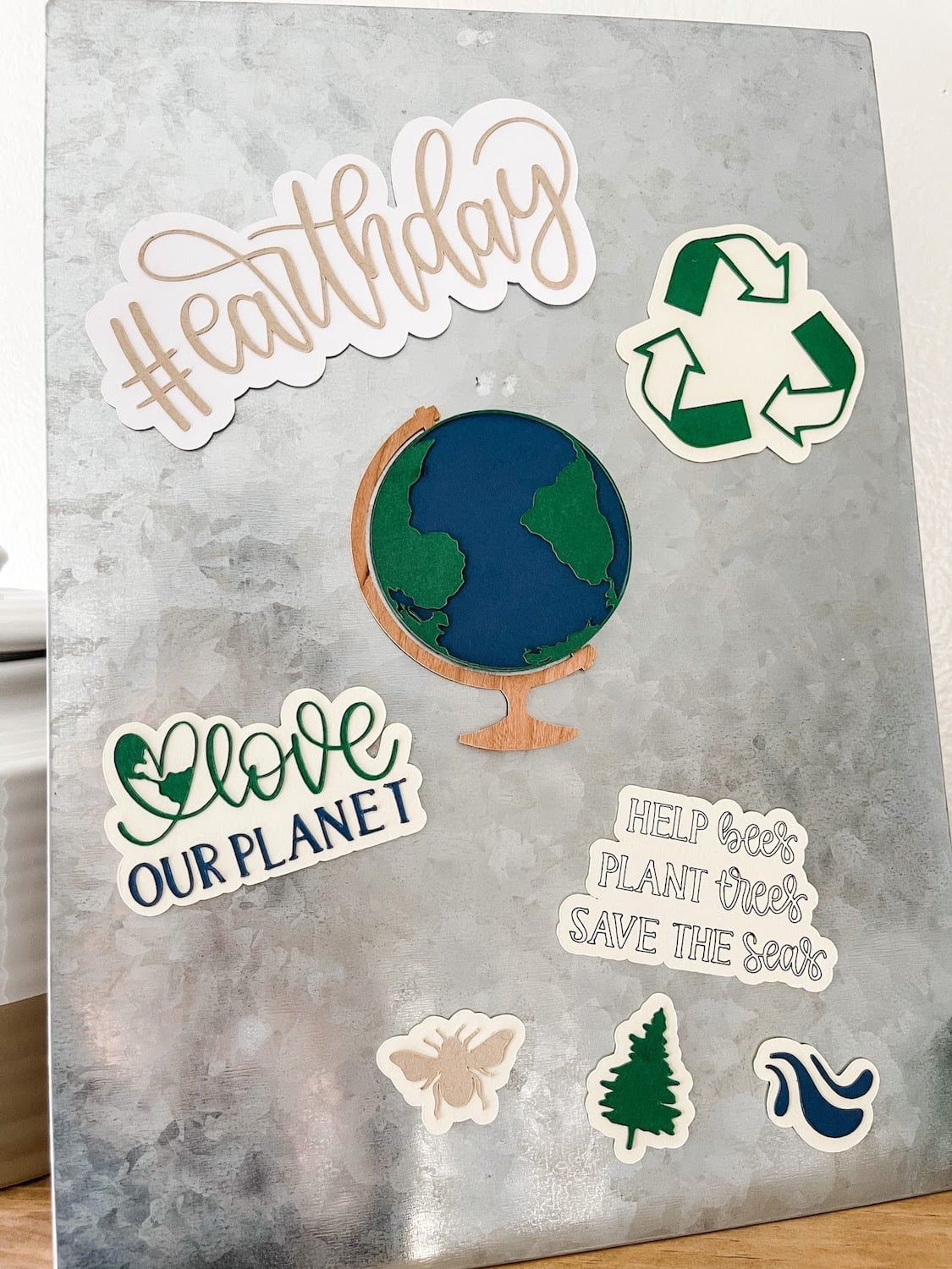 Finished earth day magnets on a metal board