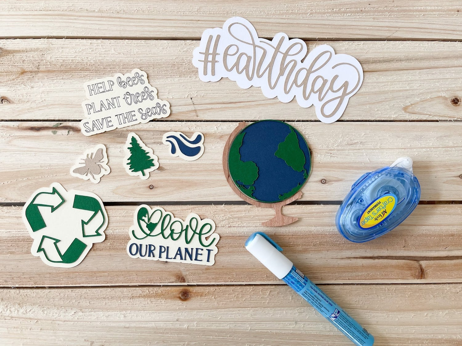 assembled die cuts for earth day magnets with zig glue pen