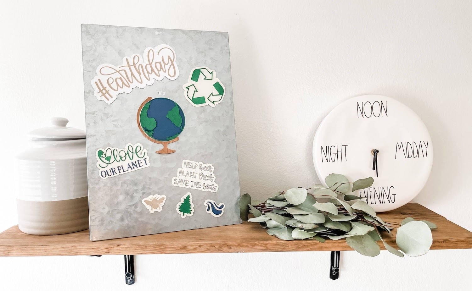 Earth day magnets on a metal board on a shelf