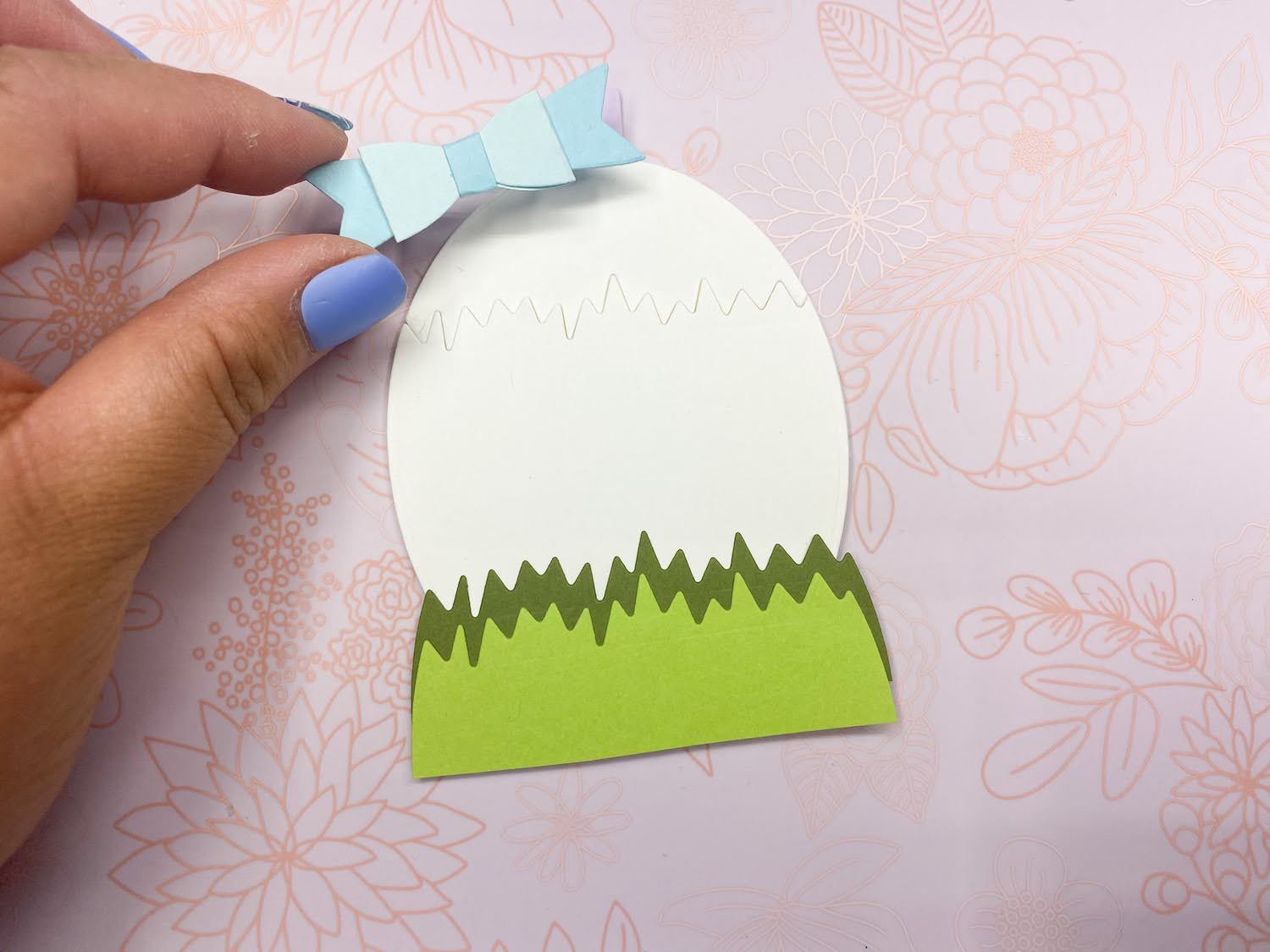 Adding bow to Easter Chick in Egg Basket Tag