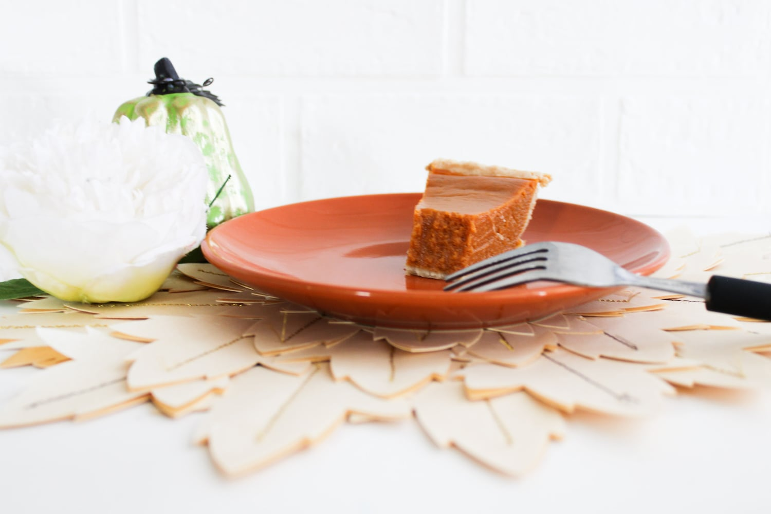 Fall leaf placemat with a slice of pumpkin pie