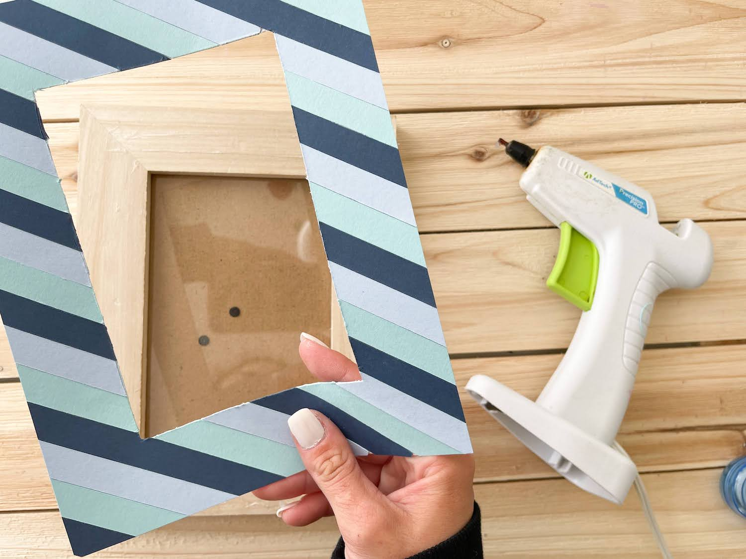 adding paper frame to outside of wooden frame
