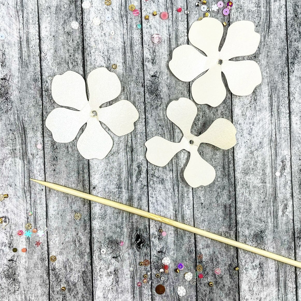 Flower die cuts with wood skewer