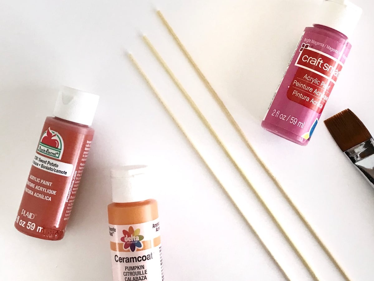 painting wood skewers for paper flower decor