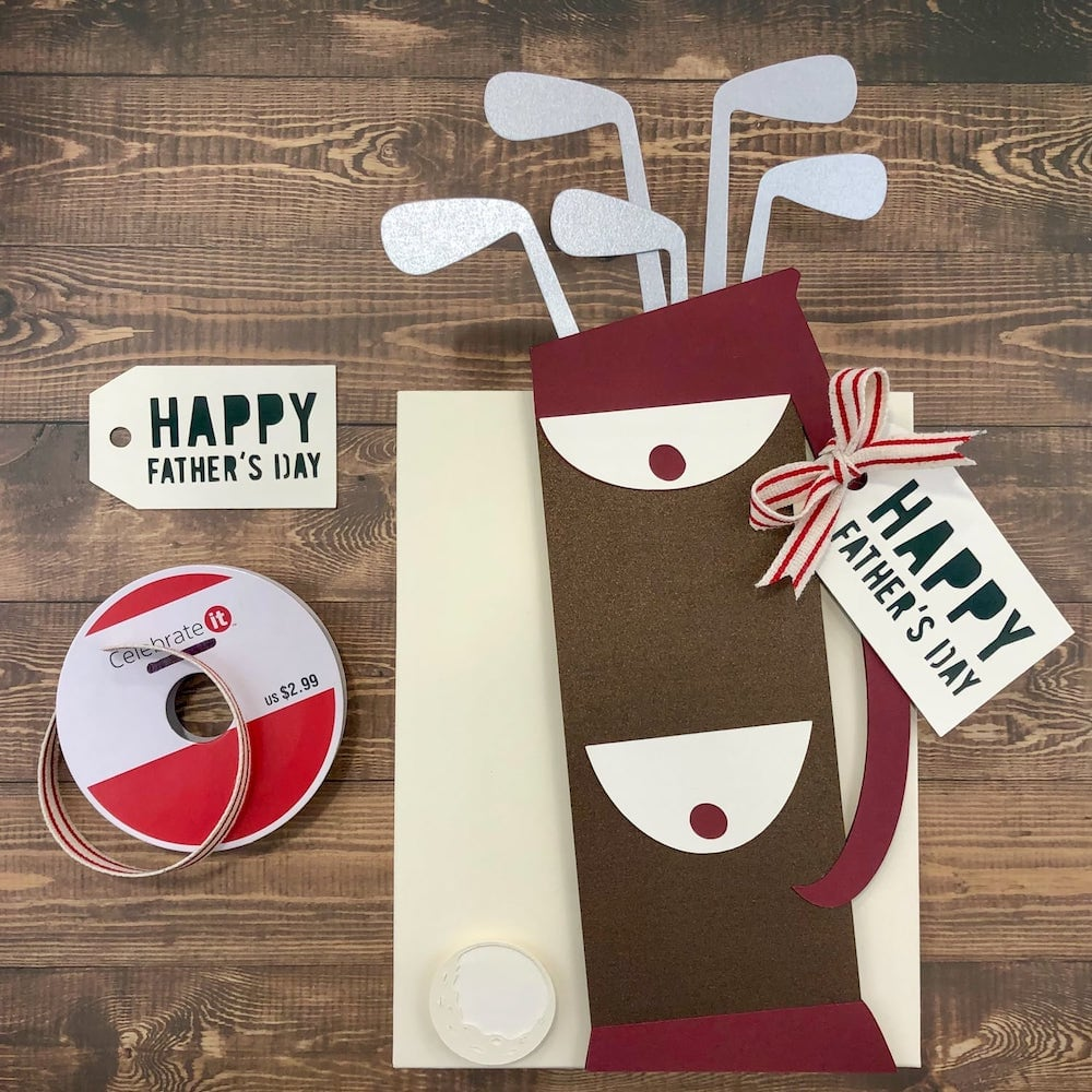 adding ribbon to handle of paper golf bag