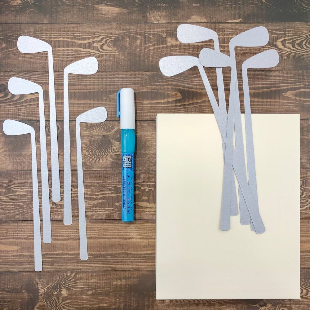 attaching golf clubs to father's day gift bag