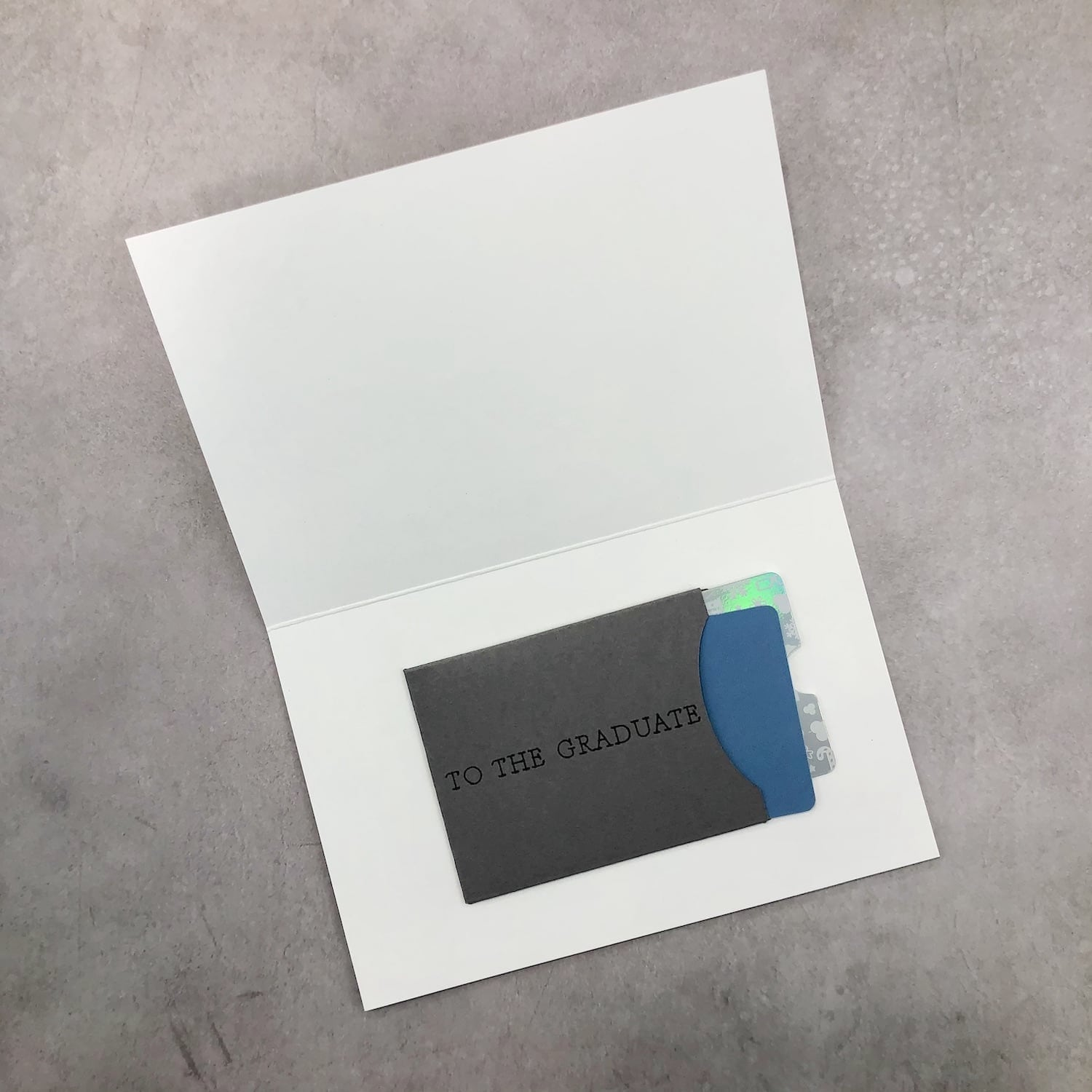 inside of card with gift cards in holder